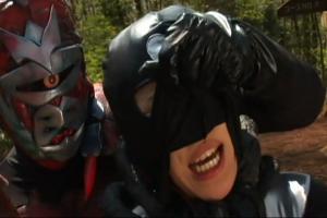 He grabs her mask...